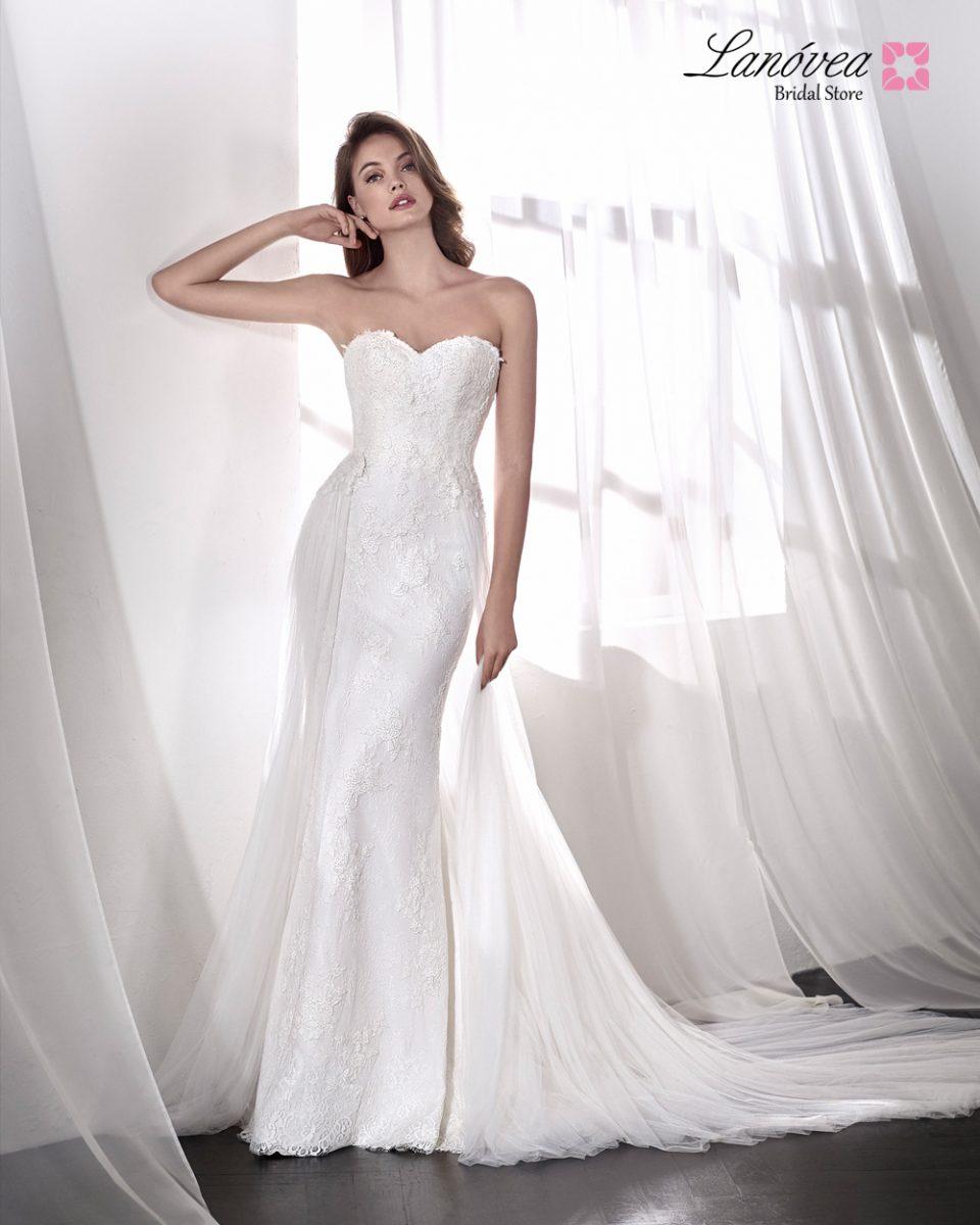 Vestido de novia con sobrefalda